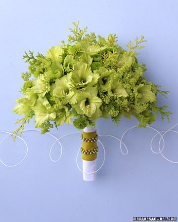 Hand-Wired Fan Bouquet  This assembly of flowers in shades of green attains its fanlike silhouette through the use of wired gladioli and santini mums