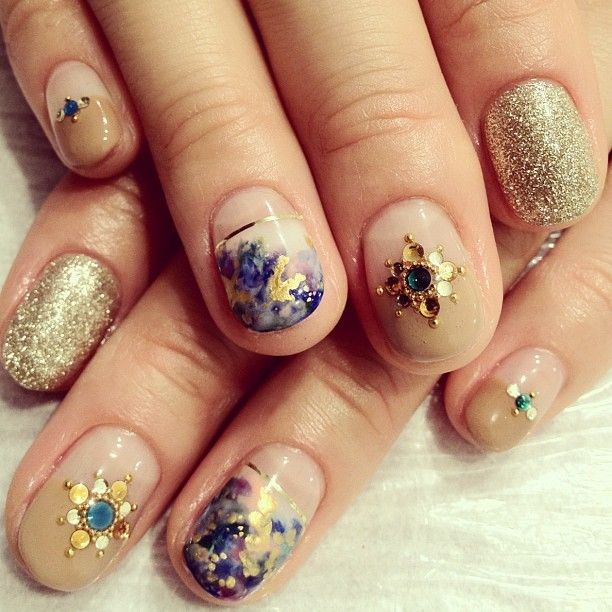 Golden Rosette Nail Art with Round Glitter and Caviar Beads.