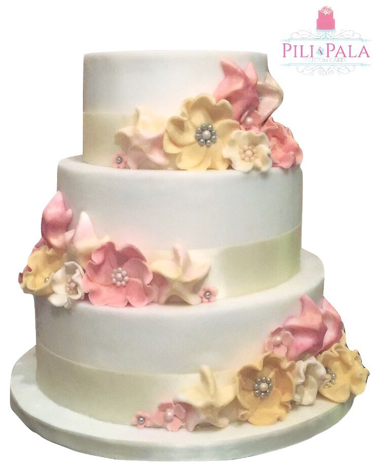 3 tier beach wedding cake with fantasy flowers and starfish in white, Ivory and blush shades