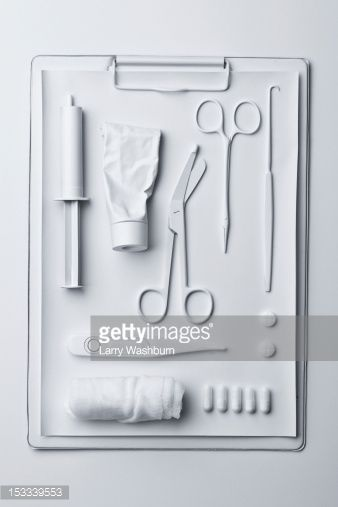 Stock Photo : Medicine and medical equipment painted white and laid out on a clipboard
