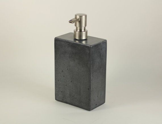 A simple, minimalist design.  $62  Classic concrete structure.  8 1/2 H x 4 1/4 W x 2 1/2D  Stainless steel soap pumps: Modern Flat Head.  Finished with an