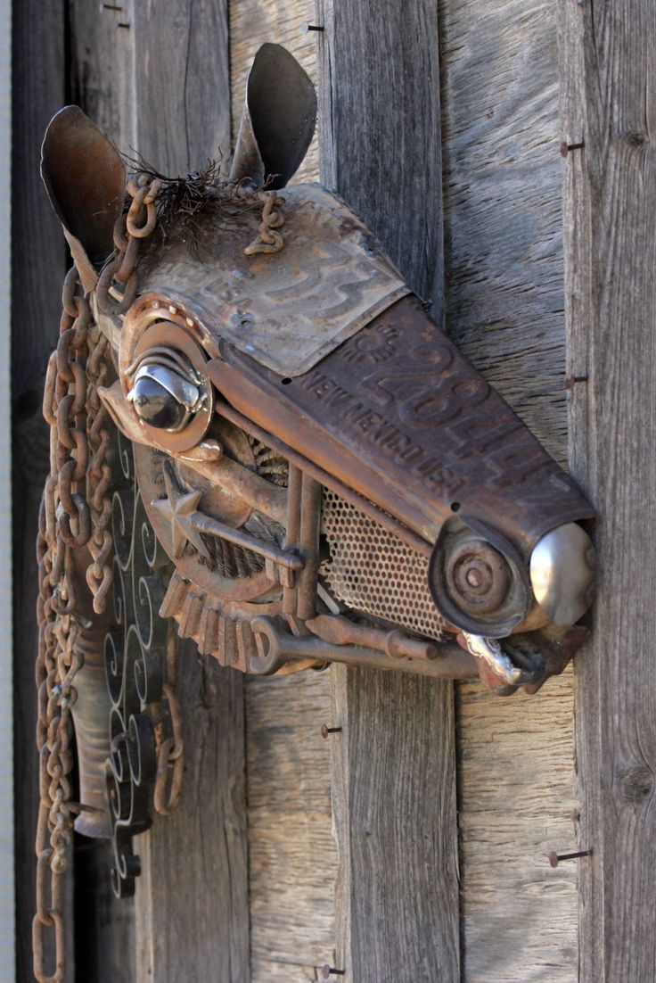 Old, rusty car parts, gas cap nose, spoon muzzle. - Stunning horse made from 1971 and 1972 license plates for his face. His parts include useless tools, rusty chain, broken auto parts, discarded flatware.