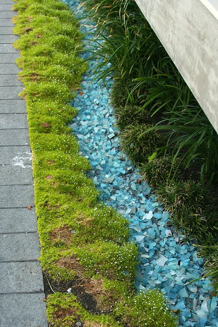 Oooh...I can TOTALLY see this crushed glass used in a Fairy Garden to give the appearance of water. Also love the bright color of the moss. Happy!