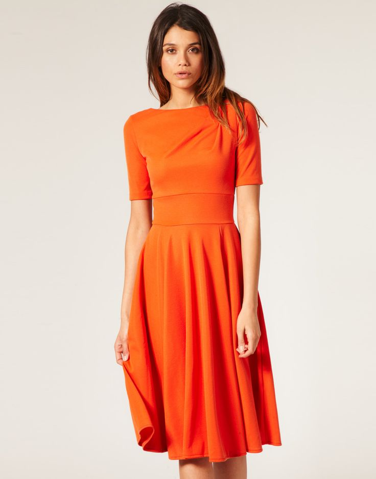 ASOS Ponti Midi Dress with Flared Skirt $87 Tailored midi dress, featuring a high slash neckline, asymmetric stitched darts to the shoulder with a fitted waist, flared A-line skirt, crop sleeves with a deep v to reverse and a concealed zip closure.