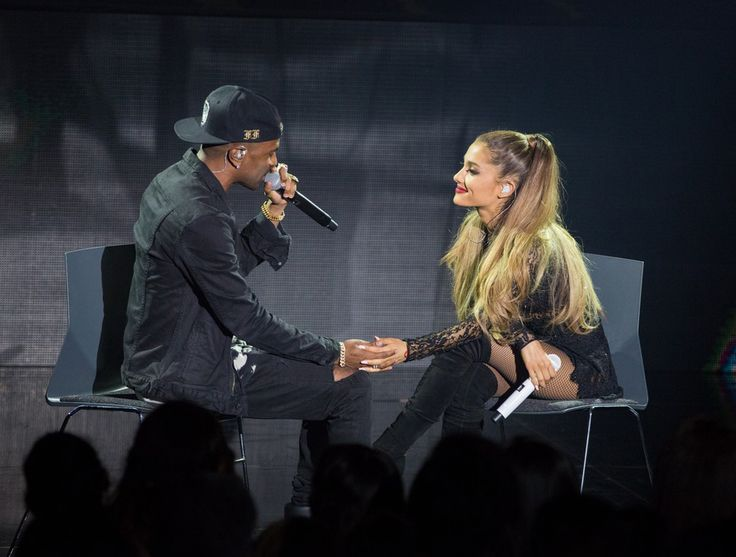 Ariana Grande and Big Sean held hands on stage during a concert.