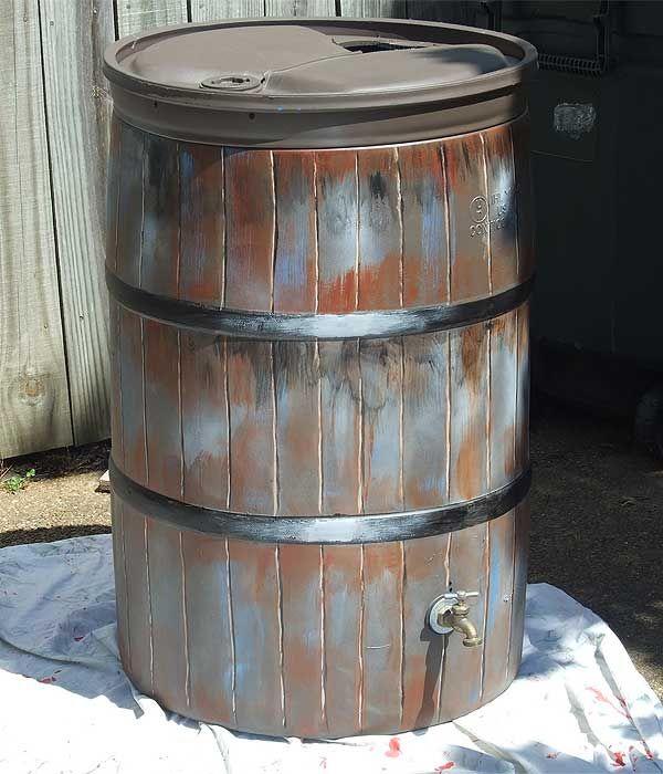 Paint a plastic rain barrel to look like a wooden barrel.