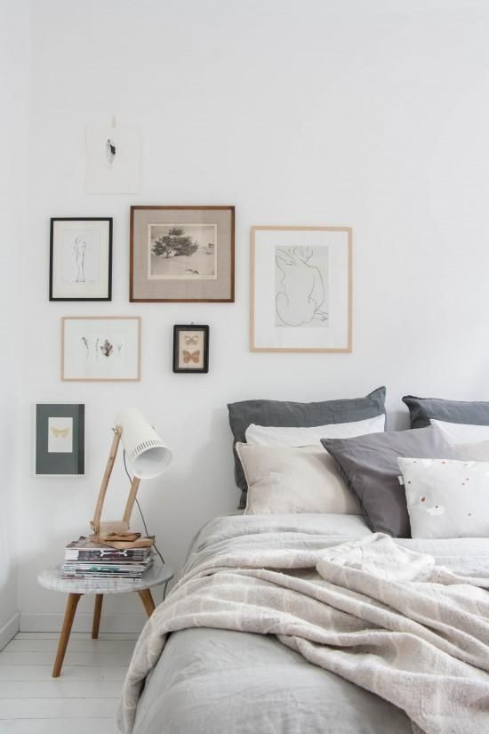Create a mini gallery wall next to your bed.