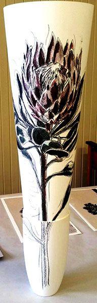 Hermien Van Der Merwe;  Title: Protea drawing in Vase:  Koningskroon (King's Crown) Medium: Mixed media drawing on paper (pen-and-ink, graphite, watercolour) in ceramic vase Size: Drawing: 595 x 420mm; Vase:  180mm (height)