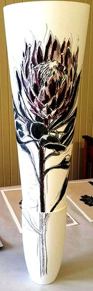 Hermien Van Der Merwe;  Title: Protea drawing in Vase:  Koningskroon (King's Crown) Medium: Mixed media drawing on paper (pen-and-ink, graphite, watercolour) in ceramic vase Size: Drawing: 595 x 420mm; Vase:  180mm (height)