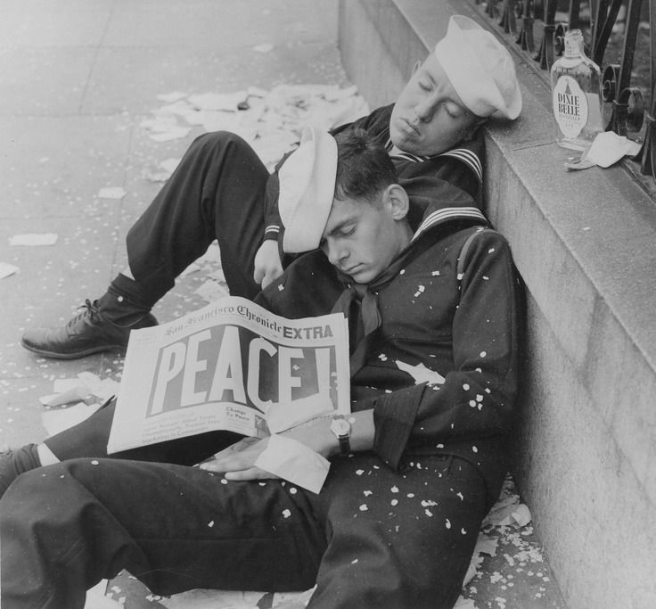 Two sailors exhausted from celebrating the end of World War II, 1945.