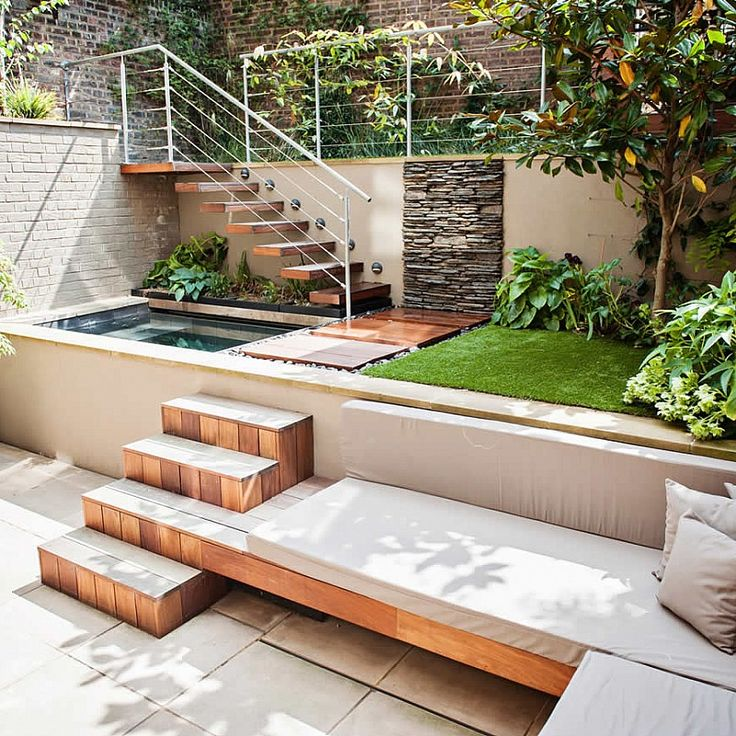 Yard, patio and hot tub in a multi-level garden backyard.
