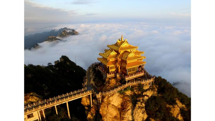 Henan, China: The pavilion atop Laojun Mountain towers over the city of Luoyang, when not obscured by clouds. The beautiful limestone peak, connected by cable car, is a popular tourist attraction in the area.