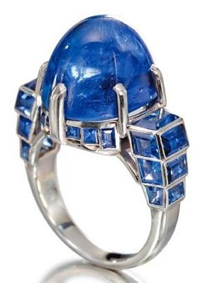 Art Deco sapphire ring by Mauboussin, circa 1930. Set with a cabochon sapphire weighing 16.93 carats, mounted in platinum