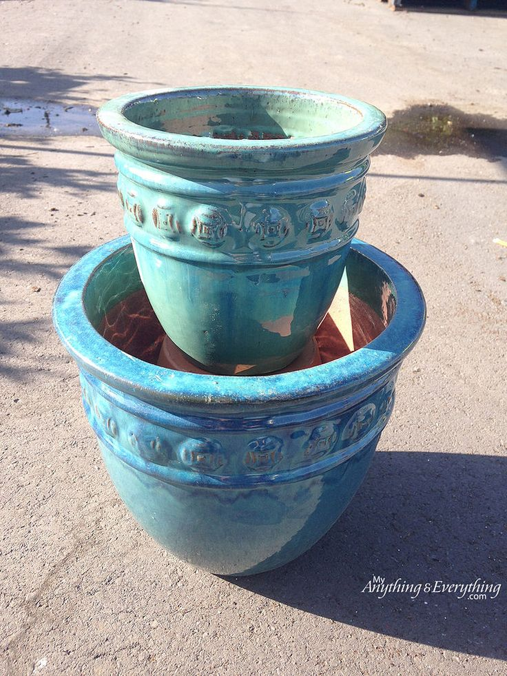 See how to put a terra cotta pot upside down in a large pot to make your neighbors smile whenever they pass your house!