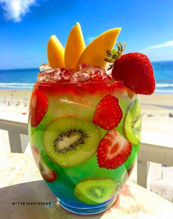 Twisted Mermaid Rum Bowl - For more delicious recipes and drinks, visit us here: www.tipsybartender.com