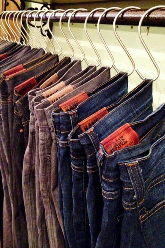Shower curtain S hooks.  Dollar Store!!  Great for hanging jeans in your closet.