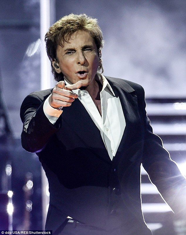 Legendary singer-songwriter Barry Manilow (pictured here performing last week) has been ordered not to speak, sing or rap for 48 ours after he was rushed to a Los Angeles hospital on Wednesday following complications from emergency oral surgery he had earlier this week