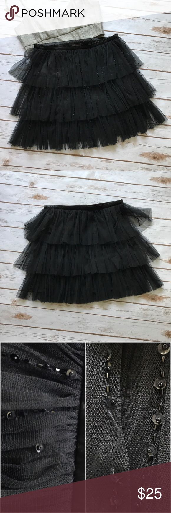 Hazel Sequin Layered Skirt Gently loved skirt. 100% polyester. Dry clean only. Sequins are only in front. Side zipper. Few sequins missing here and there and there are 2 holes in mash. Noting really noticeable. hazel Skirts Mini