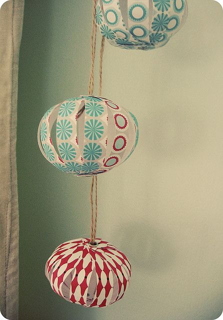 Paper ornaments from Olive Manna. http://www.etsy.com/shop/olivemanna--need to make these from book pages.