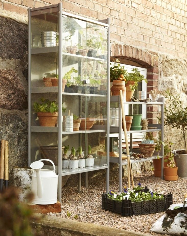 IKEA - Made of powder coated galvanized steel with glass doors, a gray Hindö Greenhouse Cabinet measures 56 3/4 inches high and 24 3/4 inches wide; $99