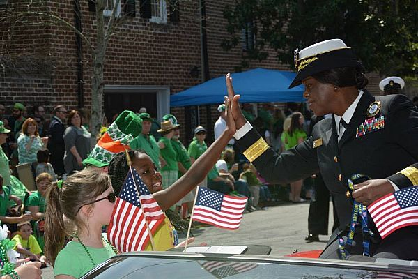 Rear Adm. Annie B. Andrews, right, commander of Navy Recruiting Command, gets a high-five during the 191st Savannah St. Patrick's Day Parade in Savannah, Ga. (U.S. Navy photo by Chief Mass Communication Specialist Heather Ewton/Released)