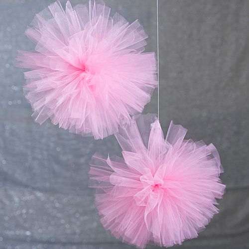 Get crafty with DIY Pink Tulle Pom Poms! Our DIY Pink Tulle Poms are simple and easy to create for your baby shower, birthday party and more.