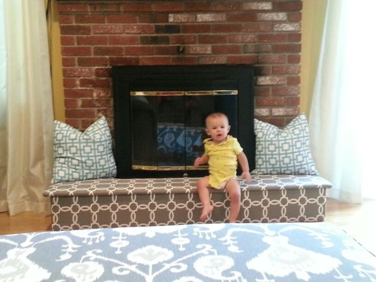 Baby proofing fireplace!  Easy to do! 1 sheet of plywood cut into 4 pieces - batting and curtains!