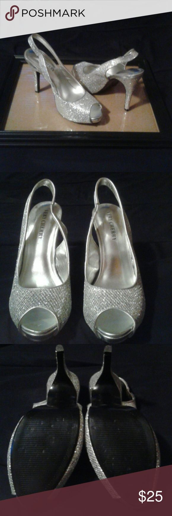 Silver Heels Gently Worn, Silver sparkly heels. Has very small spots on the side of the shoe (shown in a photo) where it has started to peel. But otherwise perfect. Very Cherry Shoes Heels