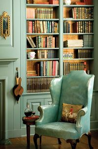Most beautiful study/ library ever. LOVE the color. And the chair. And the antique bellows.