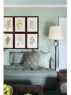 Duck egg blue walls, simple artwork and a cozy modern sofa makes this family room chic yet lived-in.  Barry Dixon Inspirations