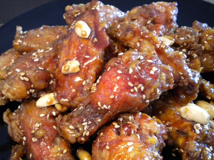 Korean Style Chicken Wings - Dakgangjung  Aww the famous Korean chicken wings with that awesome sweet candy like sauce with a great taste of sesame seeds and roasted peanut. I have to say that this Korean dish is one of my favorites and I hope that you try it and see what I mean.