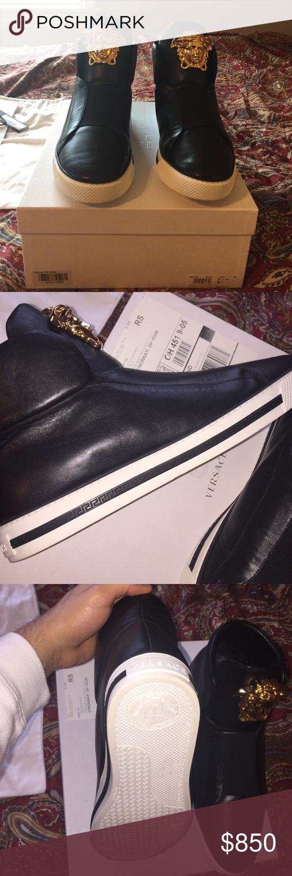 Mens Versace sneakers 12 us 45 eu Mens rare Versace sneaker with medusa gold buckle tongue. Black/ white contrast coloring with the black stripe on side they do not make no more. Size is 12 us 45 euro. 9/10 these shoes were worn once. Paid 1200. My Price I'm selling is firm. No trades Versace Shoes Sneakers