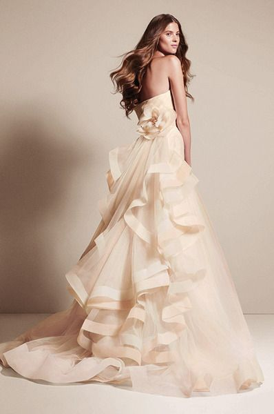 Trending This WHITE by Vera Wang gown for her Spring Summer collection is a tulle fit and flare with a unique tri colored side draped skirt back flounce and
