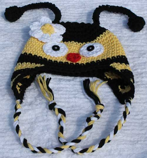 Crochet Bumble Bee Earflap Hat by mycrochetboutique on Etsy, $16.50  This adorable crochet bumble bee ear flap hat is made with 100% worsted weight cotton yarn with contrasting black and yellow stripes, topped with two antennas and adorned with braids and a cute little flower. The antennas are made with covered pipe cleaners to help them hold there shape. Please allow 3 days for this item to be completed.