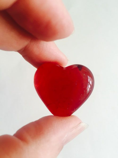 Red glass heart charms are a nice gift to the guests at a memorial or celebration of life.  Put them out on the table next to the register book.  Or if there is a meal, put them on the plates.  Friends and family can keep the hearts as a reminder of their loved one.  #funeralgift #memorialgift #celebrationoflife