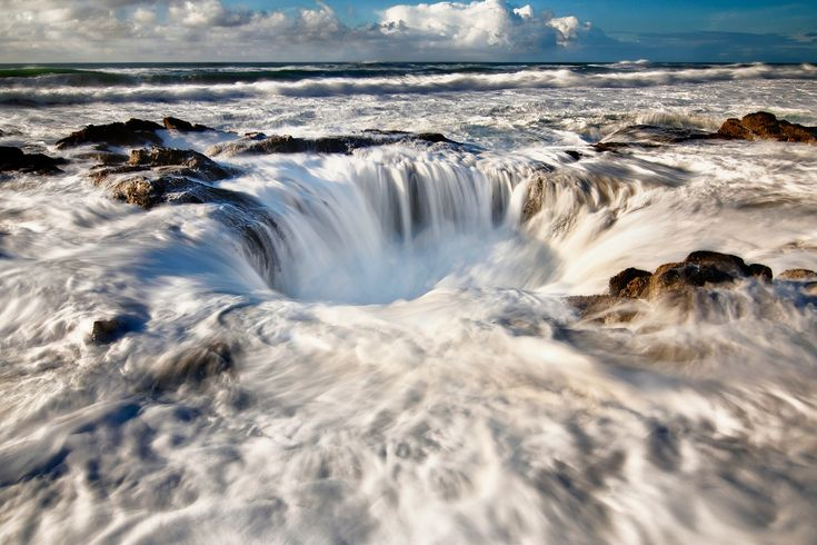Thor's Well in Oregon - Many people, I believe even the locals of Oregon do not realize the existence of an amazing nature place called Thor's Well. Located at Cape Perpetua, Oregon, the surf surge rock without doubt is very unique. In any event, it makes a great photo. It occurs at a moderate to high tide with strong surf.