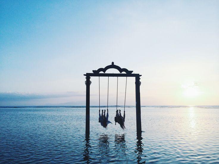 Miann Scanlan swinging in Bali paradise ocean swing sunset