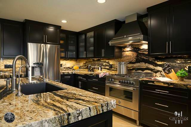 Granite tops, black cupboards and a stainless #Bertazzoni #Professional stove!