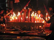 some people will pay to go to the temples and burn incense in order to get good fortune and a prosperous year from Buddha. the first people of the year are the most favored.
