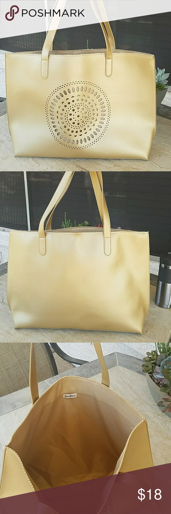 """NWOT Gold Tote Bag New without tags, large gold tote bag. Brand: Neiman Marcus. Length: 20"""", height including straps: 23"""". Does not have a zipper. A few small marks on back otherwise no damage or defects. Comes from a smoke free home. Final price unless bundled. No trades, no holds, thank you. Neiman Marcus Bags Totes"""