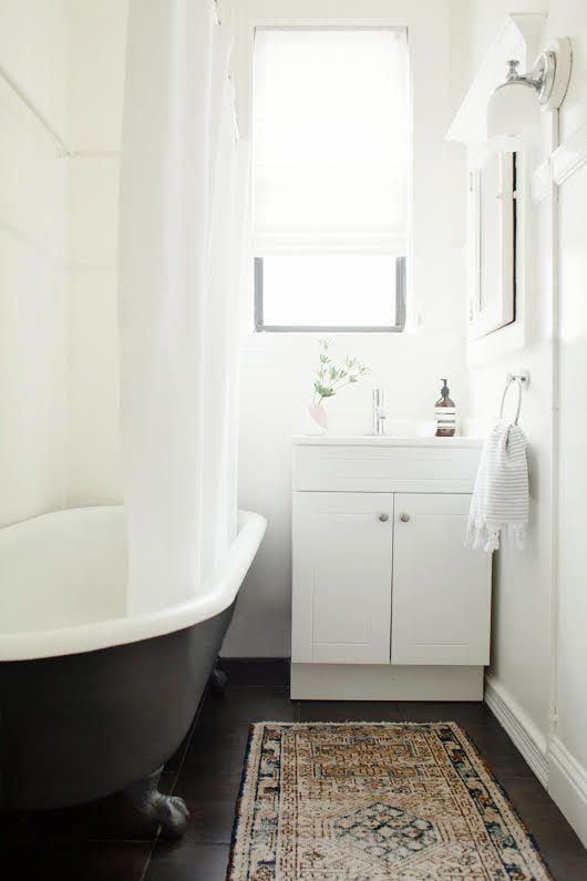 A coat of BEHR Marquee Graphic Charcoal Stain Blocking Paint & Primer on the clawfoot tub!