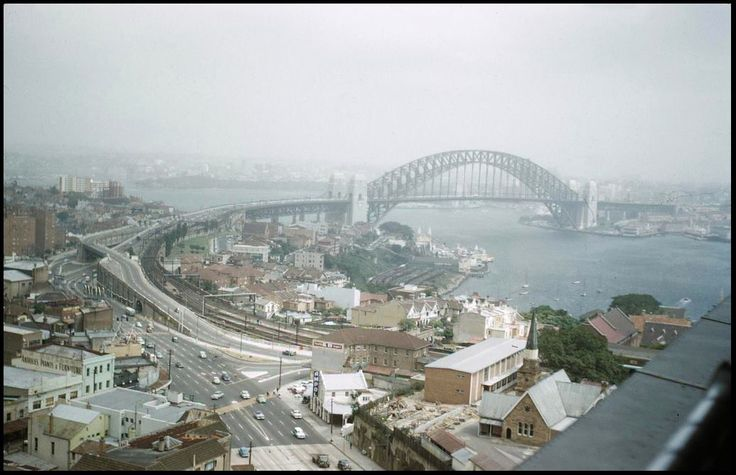 A view of the Sydney Harbour Bridge, from North Sydney, before the Warringah Freeway was completed.(Photo undated). v@e