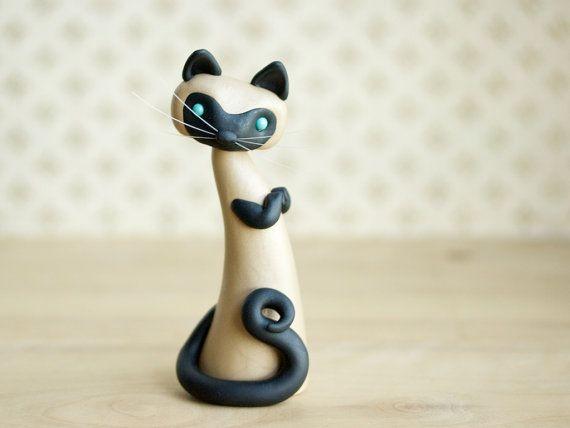 He encontrado este interesante anuncio de Etsy en https://www.etsy.com/es/listing/98366403/escultura-de-gato-siames-de-bonjour