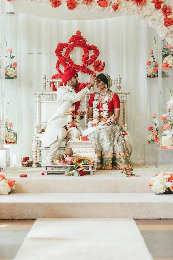 LOVE this modern look on white, with the floral ganesh and simple mandap for an indian wedding