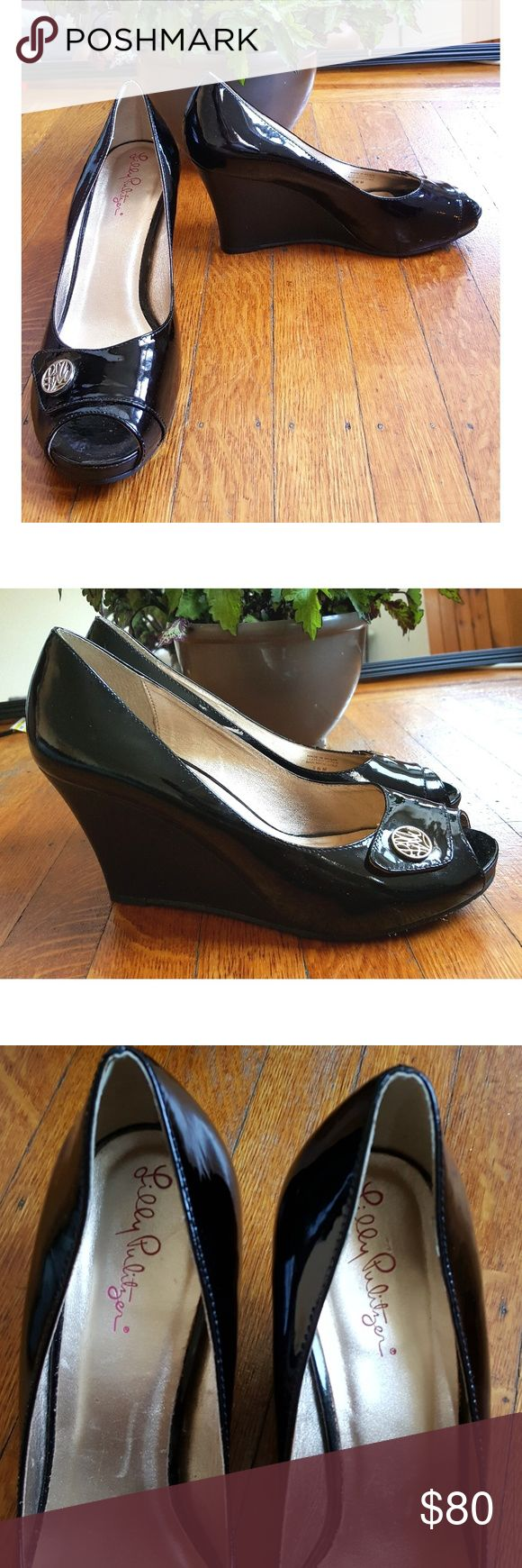 Lilly Pulitzer resort chic wedge Gorgeous patent leather Lilly Pulitzer resort chic button wedge heels. Opwn toe style.  Has Lilly logo on button.  Approximately 3 1/2 inch heel.  EUC. Lilly Pulitzer Shoes Wedges