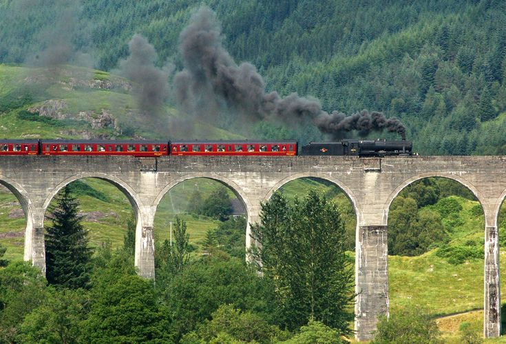 The real life Hogwarts Express through Scotland-- haha or at least this is the gorgeous area where they filmed the train scenes--Glenfinnan, Scotland, which btw I've been to ;)