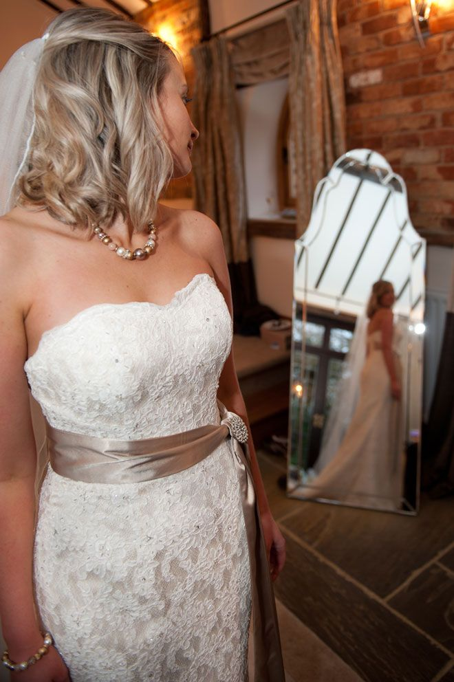 Bride gettting ready in the Cornstore Cottage at Rivervale Barn wedding venue | www.allabouttheimage.co.uk