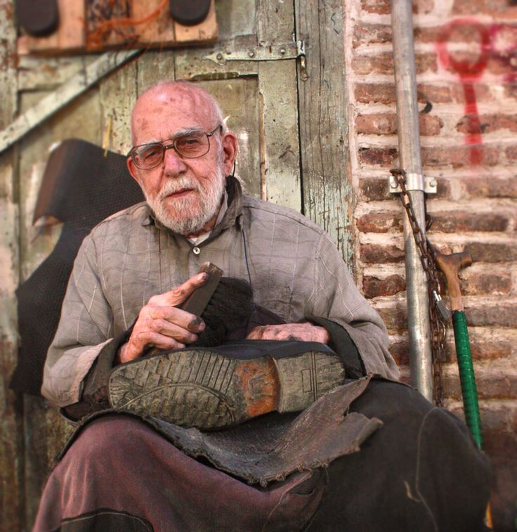 The wise Shoemaker   It makes me feel that this very big shoe in his hands is a sign of his life span ... and all the things around him like the the cane he is having ,the dust at the bottom of the shoe ,the brush he is holding, the shirt he is wearing and the wall behind him show the fatigue life of this old man... With all the tired space he is having but he is very active and makes me feel alive ... His look tells me : MOVE don't give up easily ...i always loved that look   Photo by…