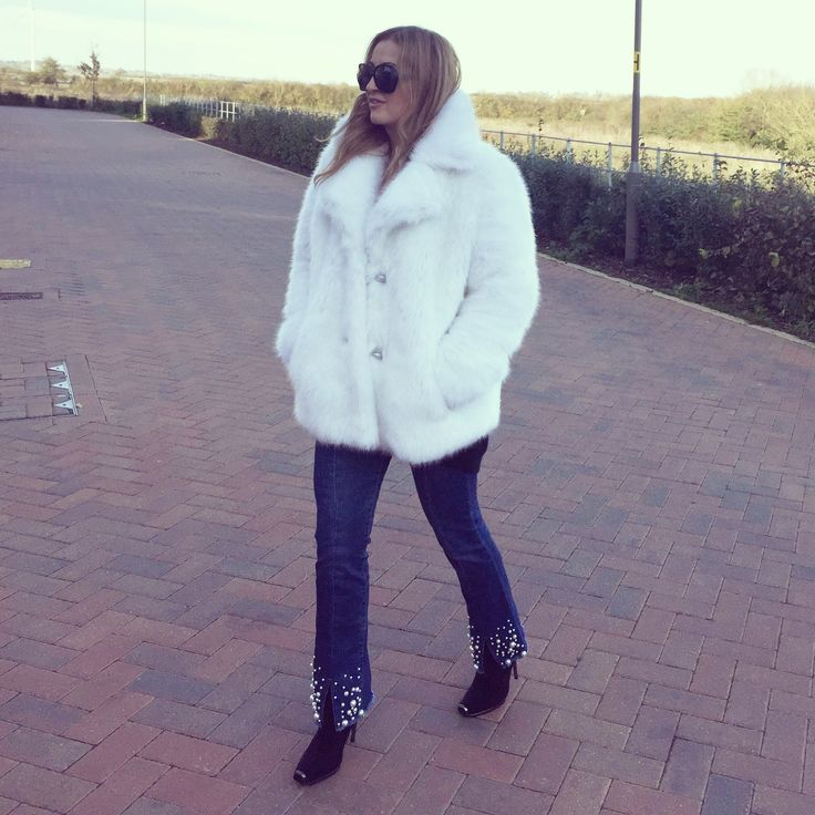 White faux fur coat by Michael Kors, pearl embellished jeans , sock boots, oversized sunglasses, winter style