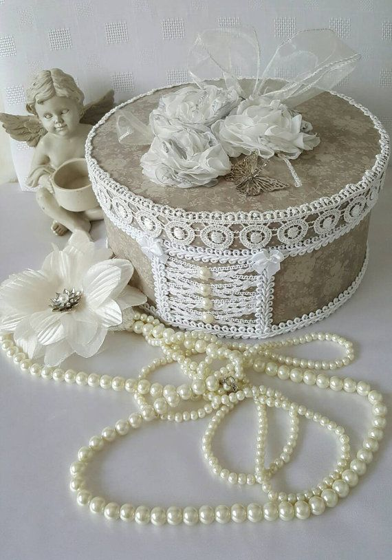 A cottage chic hat box. This is made using a strong paper mache hat box. I have painted it then added cardstock and lace and trims. This
